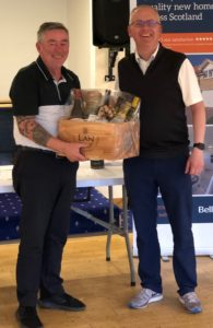 'Longest Drive' winner Gordon Lowrie receives his hamper from Bellway Homes' Iain Allison.